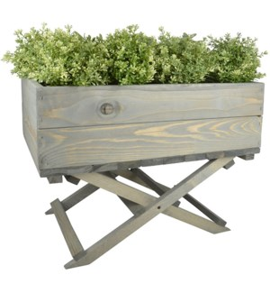 Planter on foldable stand