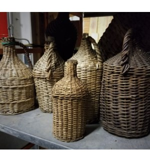 Antique Bottles in Wicker
