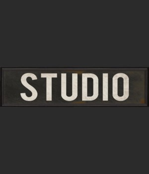 BC Studio Sign white letters on black