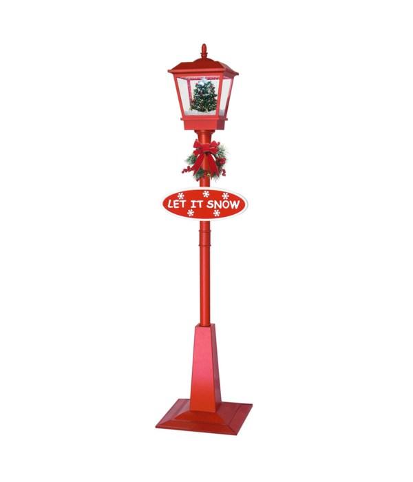 vertical snowing streetlamp 1s