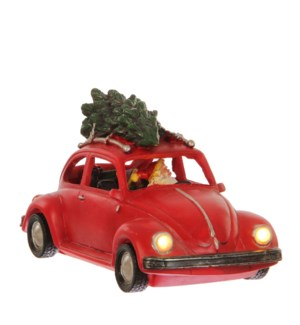 Santa driving a beetle battery operated - 9.75x5x6""