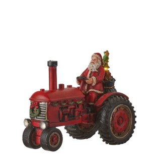 Santa on tractor red battery operated - 11.25x6x8.75""