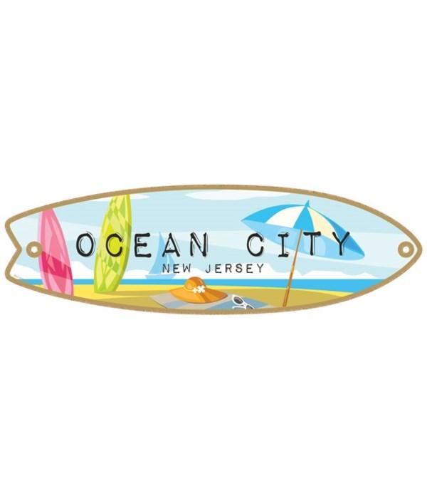 2 surfboards, sailboat in distance, umbr