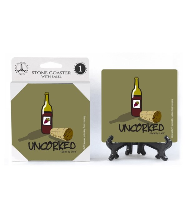 Uncorked - cork laying next to red wine