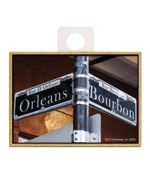 """Orleans"" & ""Bourbon"" black street signs"