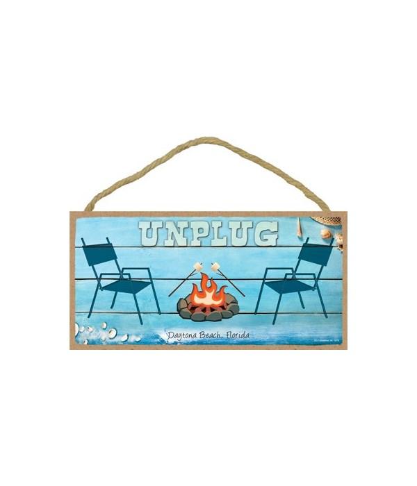 Unplug - chairs next to campfire - Beach