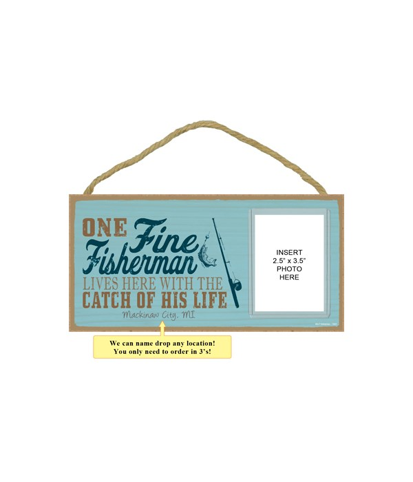 One fine fisherman lives here with the catch of his life (fishing rod image)