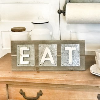 Metal Eat Sign On Natural Wood