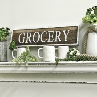 White Grocery Sign On Natural Wood
