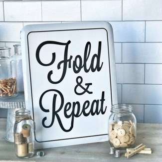 White Enamel Fold And Repeat Sign