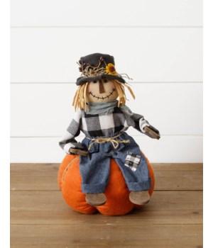 Scarecrow Sitting On Pumpkin
