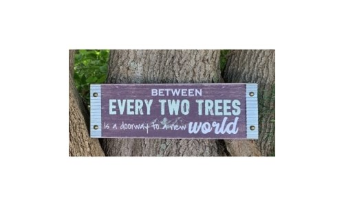 Between Two Trees Sign