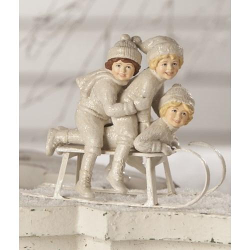 Winter Sledding Trio