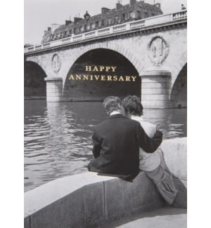 AN/Couple Sitting By A River