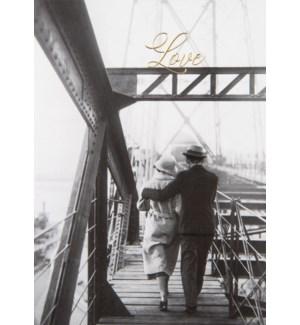 AN/A Couple Walking On Bridge