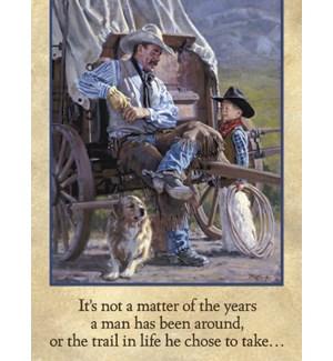 BD/Cowboy sits on wagon