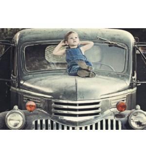 BD/Little boy on hood truck