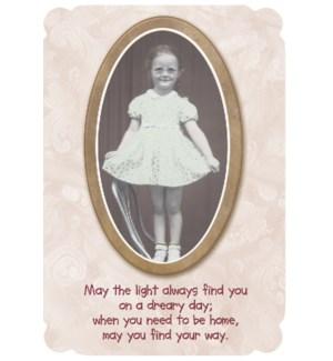 ENC/Little girl holding skirt