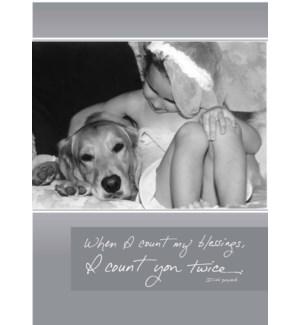 TY/Little girl hugging dog