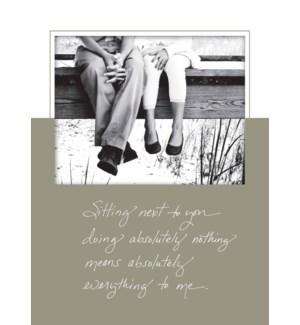 RO/Couple Sitting On Dock